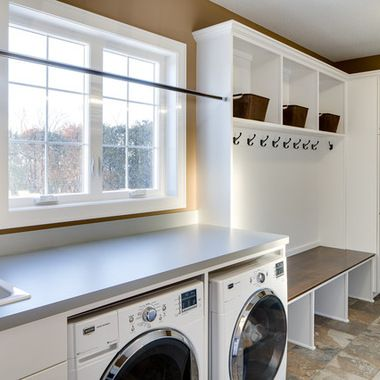 Front load washer and dryer and a counter overtop for folder.