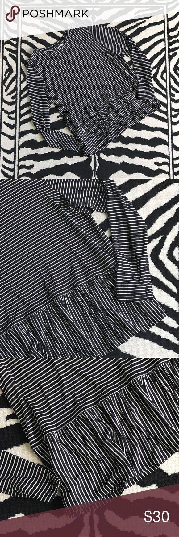 B & W Striped Peplum Top Black and White Striped Peplum Top. Long sleeved, scoop neck, peplum pleated detailing hemline with alternate stripe detailing. Old Navy Tops Tees - Long Sleeve