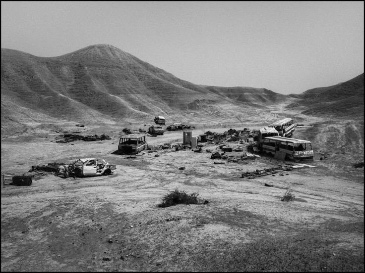 Destroyed vehicles litter a hill at the eastern entrance to Kirkuk, Iraq, 2014.