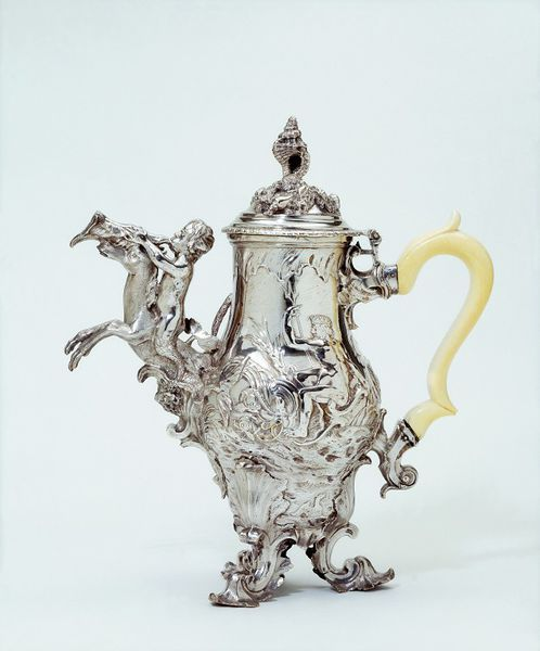 """1749-1750 British Coffeepot at the Victoria and Albert Museum, London - From the curators' comments: """"A standard baluster form of pot and cover has been transformed by elaborate and fantastical marine decoration characteristic of the flamboyant Rococo style. The form of the finial and of the spout is composed of boldly-modelled cast elements, also on a marine theme."""""""