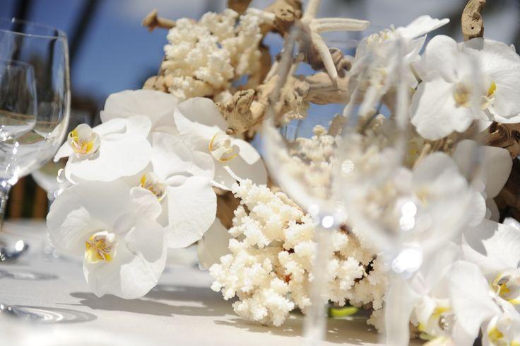 Orchid and driftwood Hawaiian wedding centerpiece