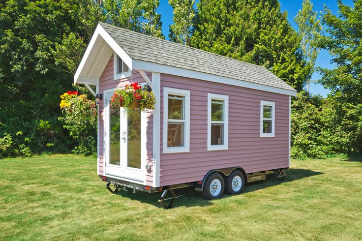 A lofted 160 square feet tiny house on wheels in Delta, British Columbia, Canada. Designed by Tiny Living Homes.