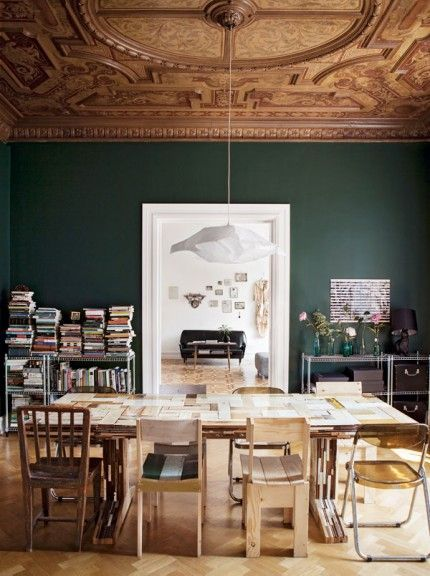 dramatic dining room | dark green walls | ornate ceiling and crown molding | minimal dining table -★-