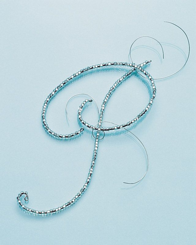 Choose letter font, print.  About 18-in of 20-gauge wire, loop one end with pliers, transfer beads, leaving about 3 inches unbeaded, loop other end.  Shape wire, cut leaving 1/2 in, loop.  For 2-piece letters, attach pieces with 30-gauge wire.  Make hook with 20-gauge.