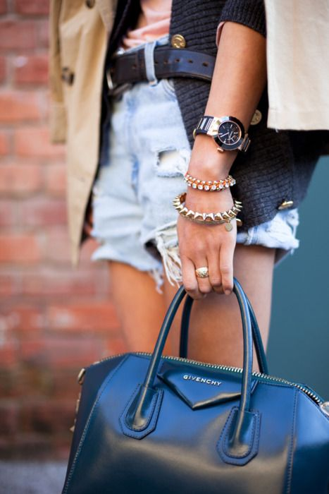 black bag, ripped jean shorts, arm candy