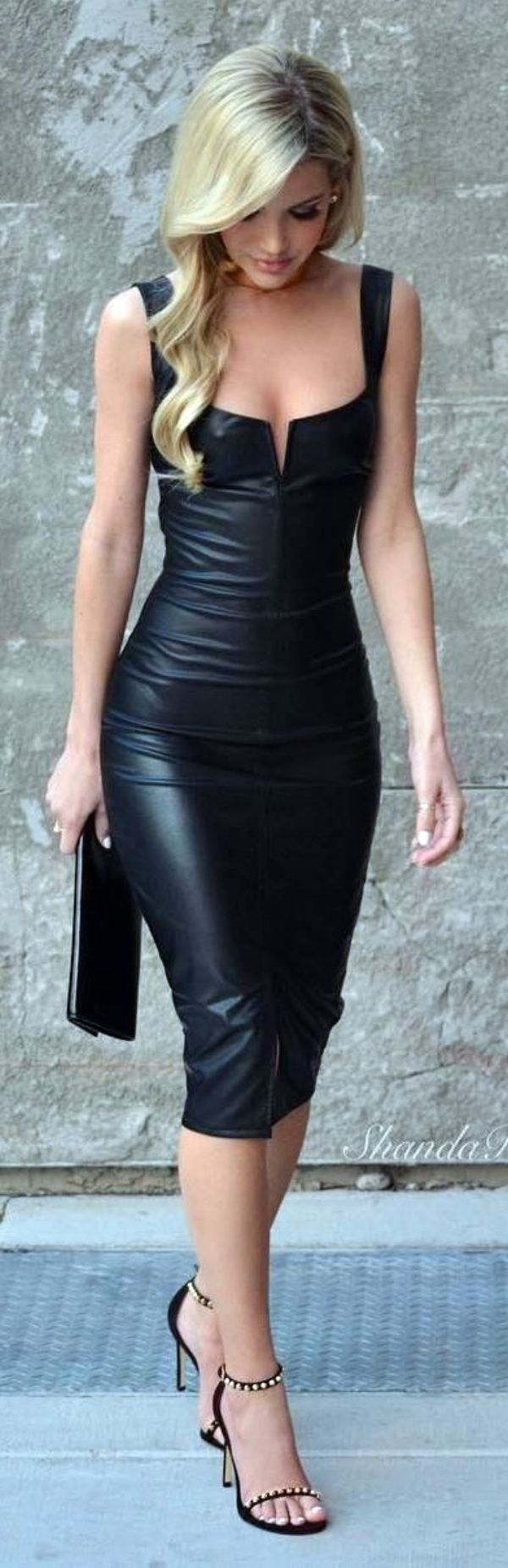 Blogger Shandra Rogers tight leath black dress.