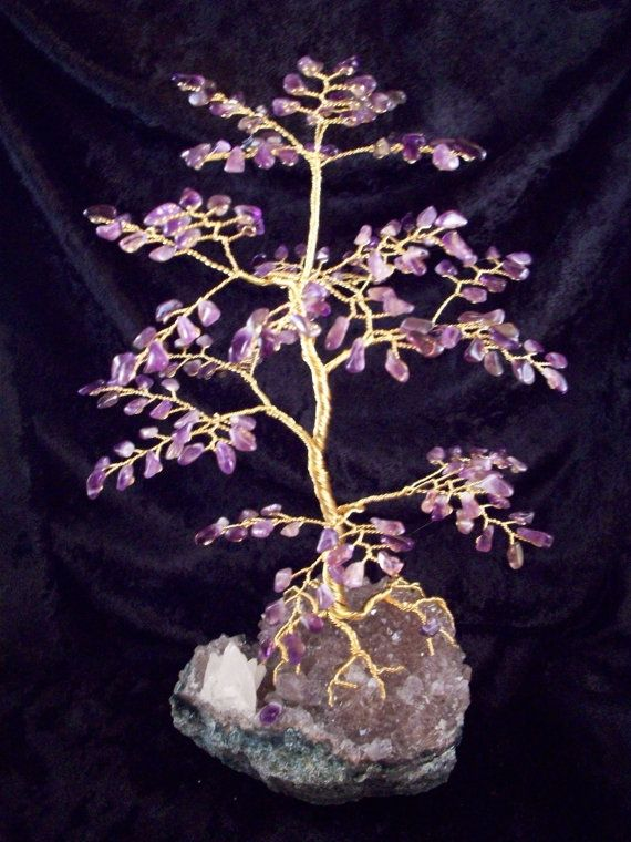 Oh PLEASE.  Mine are so much cooler.  Except the base... that's pretty nifty.    Amethyst Gem Tree by naturesarts on Etsy, $74.95