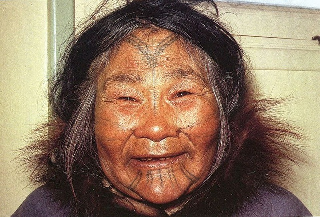 "Just found this image in a book after pinning it ages ago from Flickr. The description says ""Homaok, an Utku born in Oudjoulik in 1895."""