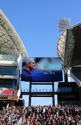 The tribute to the late Phil Walsh on the screen at Adelaide Oval. Pic: Daniel Kalisz/Get