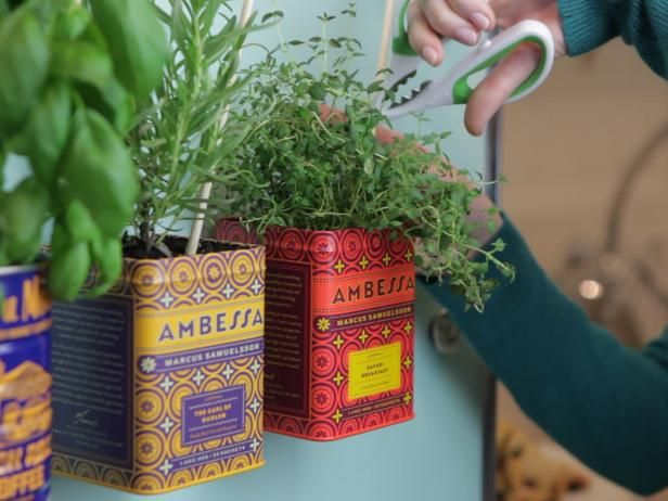 HGTV.com shows you how to upcycle metal tea and coffee tins to create an adorable magnetic herb garden for your fridge.