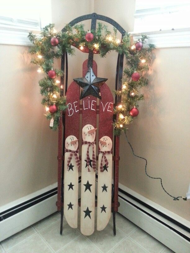 Antique snowman painted sled