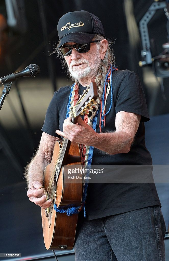 Musician Willie Nelson performs during the Oklahoma Twister Relief Concert to benefit United Way of Central Oklahoma May Tornadoes Relief Fund at Gaylord Family Oklahoma Memorial Stadium on July 6, 2013 in Norman, Oklahoma. To donate go to www.unitedwayokc.org or text REBUILD to 52000.