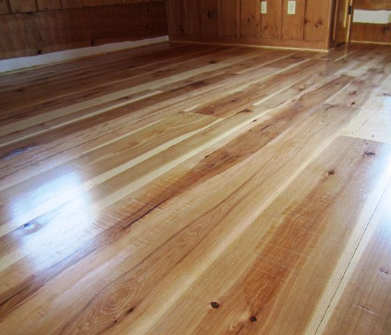 natural hickory flooring   Skip planed Hickory wood floors in a rustic Virginia cabin.