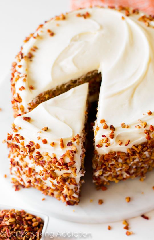 Sally's Baking Addiction | Simple and moist two-layer carrot cake with pecans and cream cheese frosting! Great Recipe!