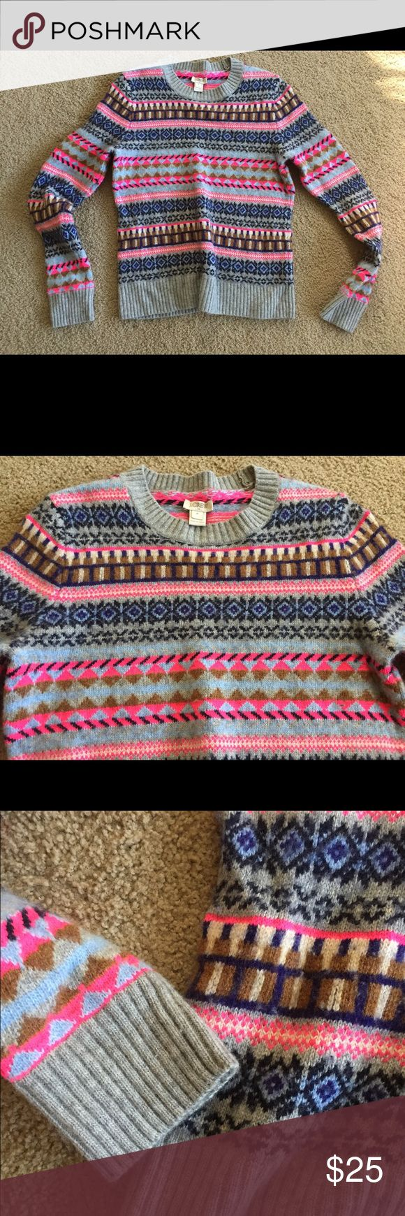 J. Crew Sweater Gray neon Aztec Tribal Crew Neck Women's size MEDIUM J.Crew wool blend sweater with Aztec / Tribal design. Gray with neon pink and blue design. Unique design, Crew neck. Outlet item! Tag is starting to come off but the sweater itself is in excellent condition! Wonderful addition to a fall / winter wardrobe J. Crew Sweaters Crew & Scoop Necks