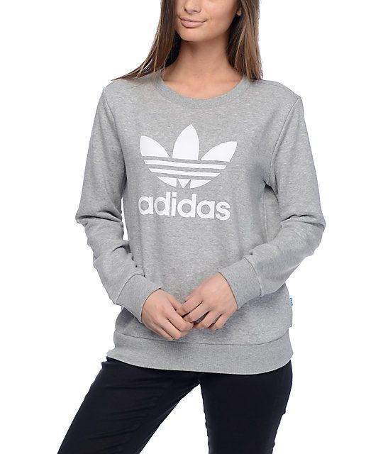 The Trefoil heather grey crew neck sweatshirt from adidas features a white Trefoil adidas logo on the front with the text logo below and is finished with a French terry lining for comfort and lightweight warmth.