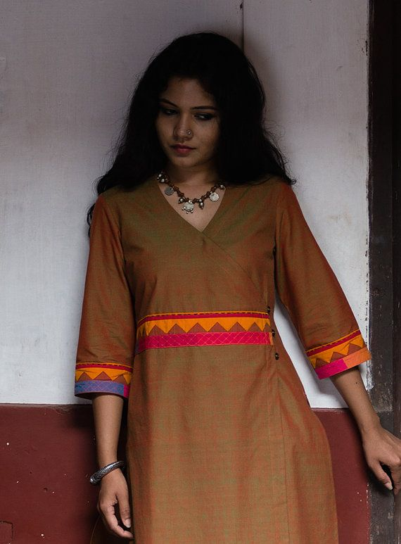 A dull mehndikurta with an overlap appliqué border at the waist. The detailis made entirely of a Theyyam inspired appliqué worked patch. This…