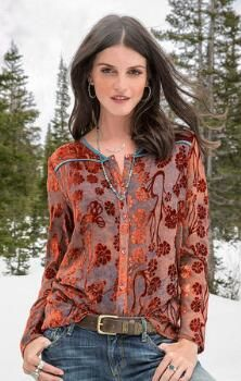 You'll love toasting the season in our elegant and soft burnout velvet top.