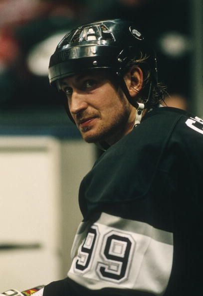The Los Angeles Kings captain Wayne Gretzky sits on a bench during a game against the New Jersey Devils at the Meadowlands Arena circa the 199293...