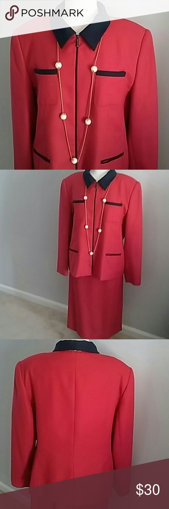 MORGAN MILLER SKIRT SUIT IN BOLD RED AND NAVY 18 MORGAN MILLER BOLD RED AND NAVY SKIRT SUIT. ZIP UP JACKET WITH 4 NAVY TRIMMED POCKETS. THE SKIRT HAS A BACK BUTTON AND ZIPPER. BOTH ARE FULLY LINED WITH A SILKY FEEL POLYESTER AND THE SHELLS ARE A WOOL POLYESTER BLEND.  THE SKIRT HAS UNTRIMMED POCKETS. SIZE 18. SHARP AND POLISHED LOOK. Morgan Miller Jackets & Coats