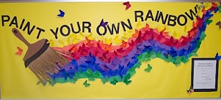 """""""Paint Your Own Rainbow"""" bulletin board display ~~~~~~~~~~~~~~~~~~~~~~~~~~~~~  """"Trying to encourage kids to reach for their dreams each student wrote one goal/dream on the back of a butterfly and then colored the other side. The butterfly was to be anonymous.  I hung the butterflies up on the bulletin board and told the kids to think about their goal or dream every time they walked by the bulletin board."""" (from the website)"""