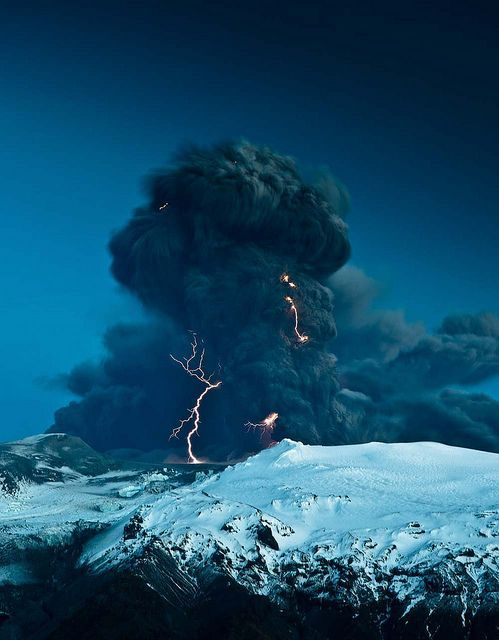 Lightning storm over volcanic eruption