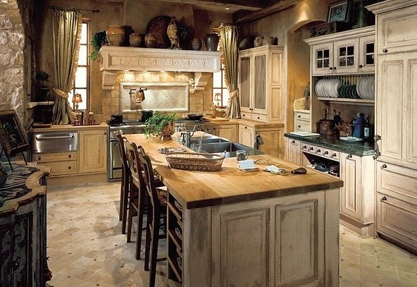 Tuscany style kitchen.  Natural elements are used in Tuscany style designs.  Granite or wood for counters, stone flooring...