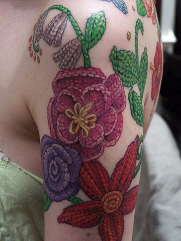 Knitted Flower Tattoo | 20 Tattoos Inspired By Crafting. Tattoos scare me but I kinda love this one.