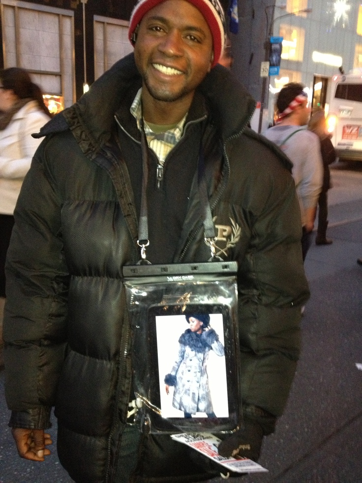 New York City - Sandwich boards go high tech. This guy had an ipad in a plastic sleeve with images of store merch. Harder to ignore a guy handing out flyers when he glows in the dark. Brilliant!