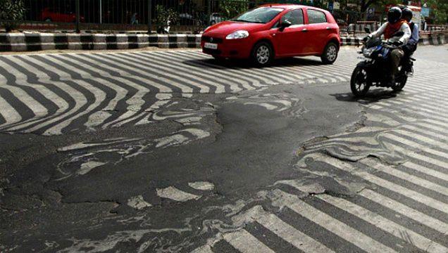 India's Heat Wave Melts Roads [Photos]