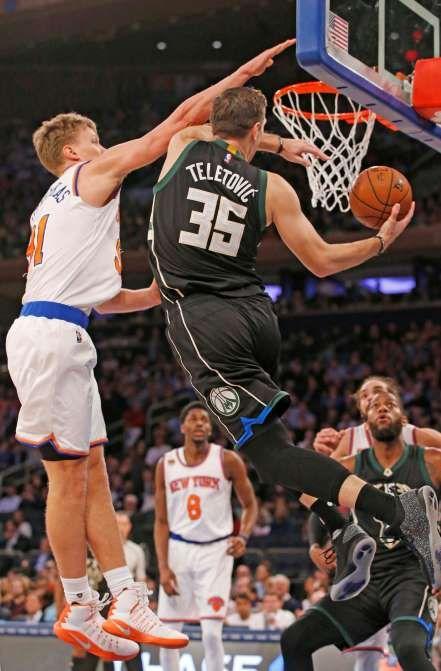 January 5, 2017:    BUCKS EDGE KNICKS  -     Knicks' forward Mindaugas Kuzminskas defends against the Bucks' forward Mirza Teletovic in the first half on Wednesday in New York. The Bucks won 105-104.