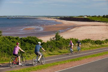 Biking on the Confederation Trail, from tip to tip of the island and many places in between!