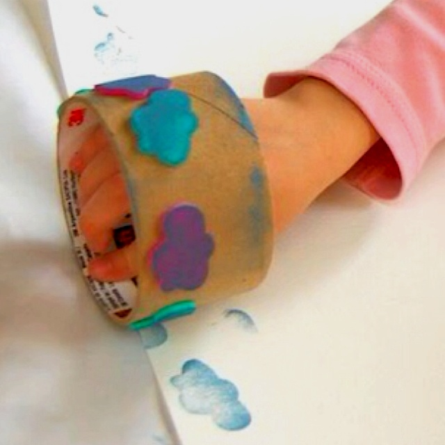 DIY Stamp wheel, with eraser stamps and packing tape roll. Genius.