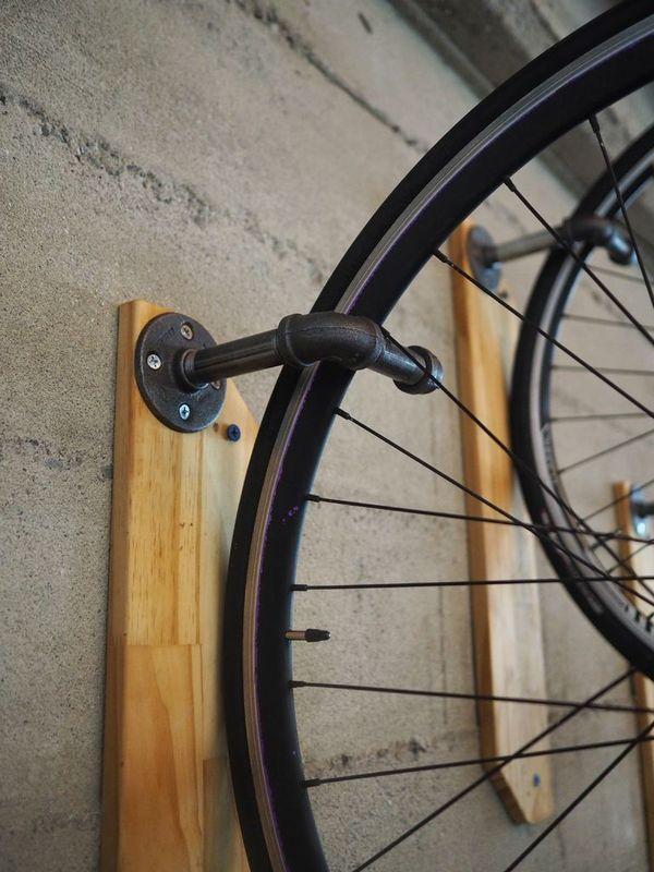 Weekend Project: Make a DIY Reclaimed Wood Wall Bike Hanger | Man Made DIY | Crafts for Men | Keywords: bike, storage, pipe, organization