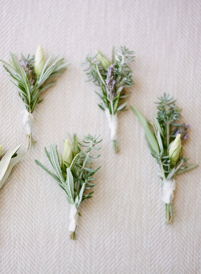 Lavender and sage bundles for the boutonnieres, adding a small anemone or garden rose bloom for the groom