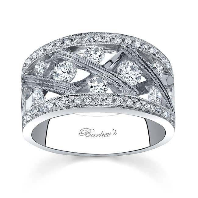347e32a19 This unique white gold diamond wedding ring features a diamond studded  lattice-work design arching across the center, while pave set diamonds  grace the side ...