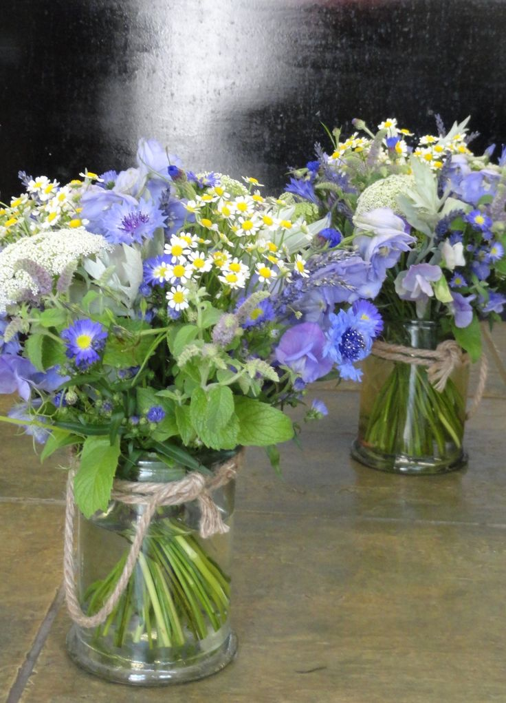 Meadow style vases of cornflower, ammi (queen annes lace), Mentha (Mint flower), Tanacetum (feverfew), September flowers, lavender, Sweet Peas, Brodea and Delphiniums.