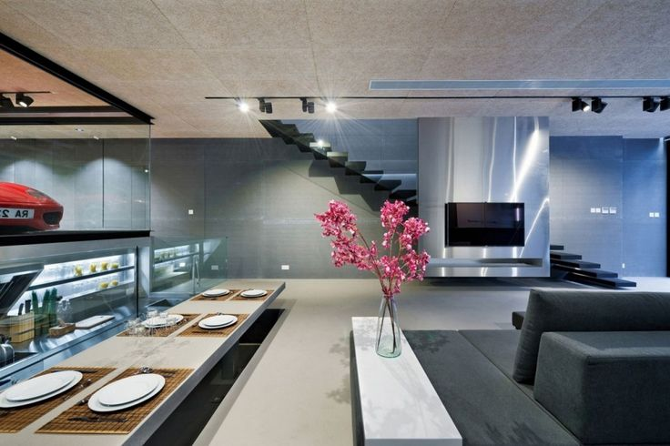Home: Open Dining Area Featuring Modern Hidden Dining Table Also Dark Grey Sofa Set And Black Lighting Fixture Plus Ferrari Car Garage With Glass Walls Ideas: Contemporary Ferrari House Remodels