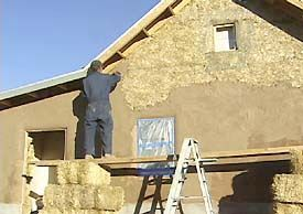 Straw bale home with exterior wall earth plaster of mud for Exterior wall plaster design