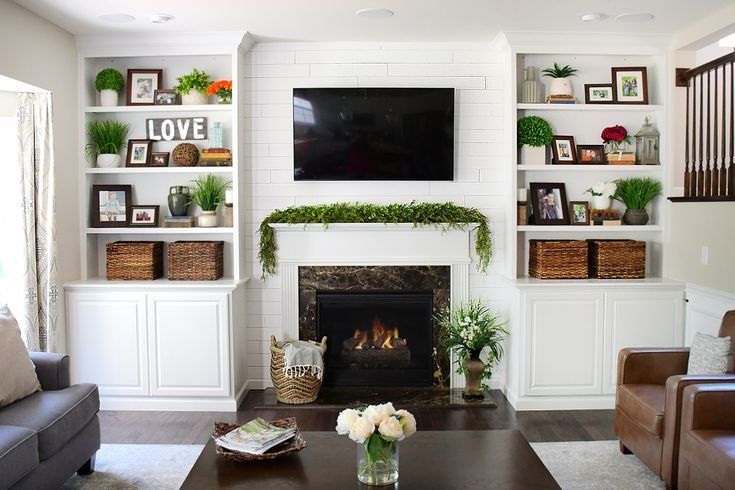 Adding shiplap to built ins around fireplace in family