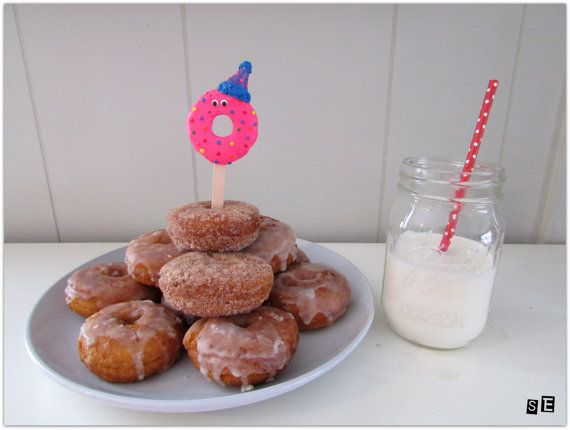 Check out this item in my Etsy shop https://www.etsy.com/listing/270545583/donut-birthday-cake-topper-doughnut