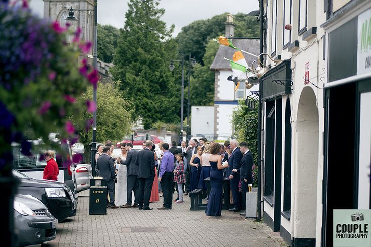 Guests make a quick stop off at The Lir Bar. Weddings at Mullingar Park Hotel by Couple Photography.