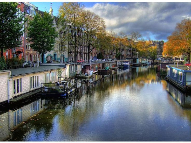 "The canals serve as a home for those who choose to live on one of Amsterdam's many houseboats. For a real Amsterdam experience think about renting a Houseboat for your vacation."" – travelwithscott via Icon's of a City….Amsterdam"