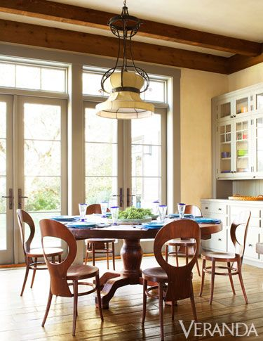 Antique dining room table with French light fixture.