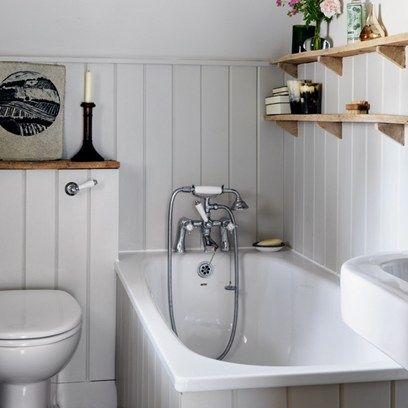 See all our small spaces design ideas on HOUSE, design, food and travel by House & Garden. This gorgeous grey panelled bathroom utilises every inch of space.