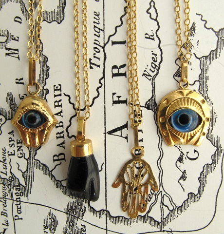 Moroccan Evil Eye Necklaces    // one of my friends in college had the golden hand (from studying abroad there!). it brought her lots of good luck