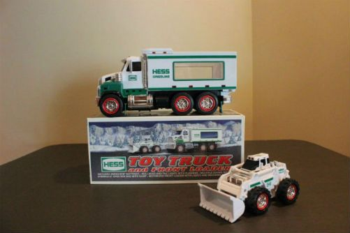 Vintage 2008 Hess Toy Truck and Front Loader. This toy is an instant favorite! The 2008 Hess Toy Truck and Front Loader. What kid doesn't like a construction vehicle right? This is another Hess first for sure. You get two toys in one with shiny chrome details, bright lights and special features. Activate the flashing lights, a backup alert signal, a gigantic-sounding horn, and a startup ignition sound with the five buttons located on the truck's cab.