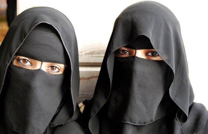 two ladies wearing Omani niqab