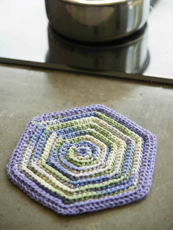 Pattern by Amy Polcyn An old 1950s kitchen set pattern inspired this super-easy hot pad that's worked in simple single crochet. Add a fun retro feel to your kitchen with this quick-and-easy project! Designer tip… Work fewer rows to make a coaster or more to make a place mat! Or try a larger hook to …