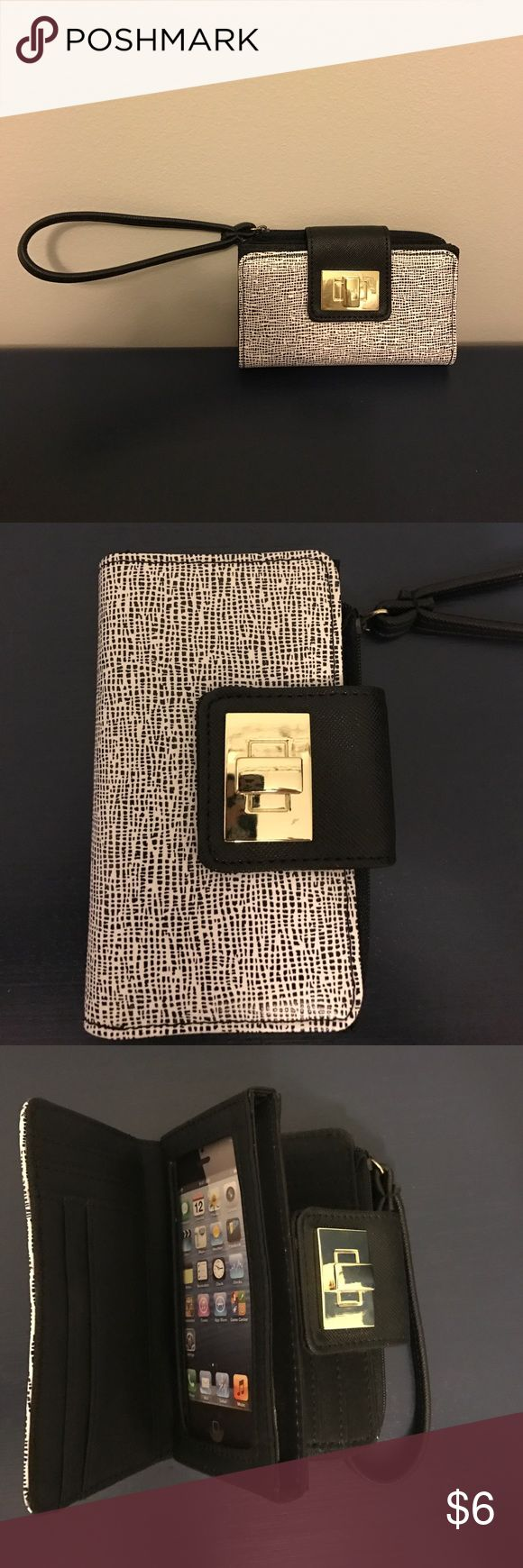 iPhone 4 wristlet/wallet. Never used Black and white wristlet/wallet for iPhone 4. Has clear window panel where the phone goes and can hold up to 10 other credit cards. Has a zipper pocket on back for change or lipstick. Buckle on front is gold. Never used excellent condition. ✅offers🚫trades Bags Clutches & Wristlets